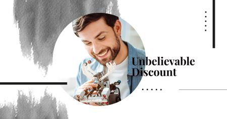 Discount Offer with Man holding Robot Facebook AD Modelo de Design