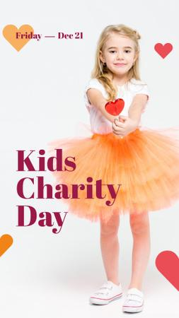 Kids Charity Day with Girl holding Heart Candy Instagram Story Modelo de Design