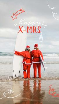 Santas with Surfboard at the Beach