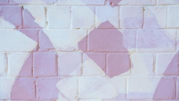 Brick wall with spots of Pastel Colors