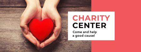 Plantilla de diseño de Charity Center Ad with Red Heart in Hands Facebook cover