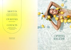 Lingerie Ad with Beautiful Woman in Pool with Lemons